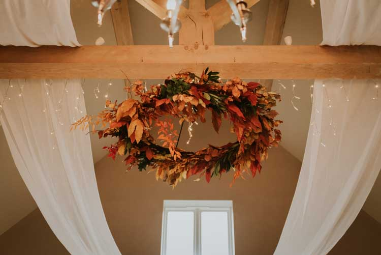 Leaf Leaves Chandelier Decor Drapes Fairy Lights Rose Gold Autumn Barn Wedding http://www.weddingphotographyincheltenham.co.uk/