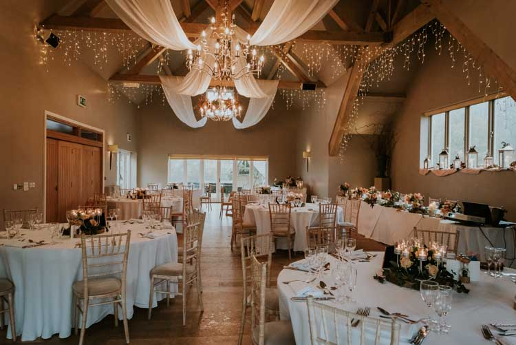 Hyde Barn Fairy Lights Drapes Rose Gold Autumn Barn Wedding http://www.weddingphotographyincheltenham.co.uk/