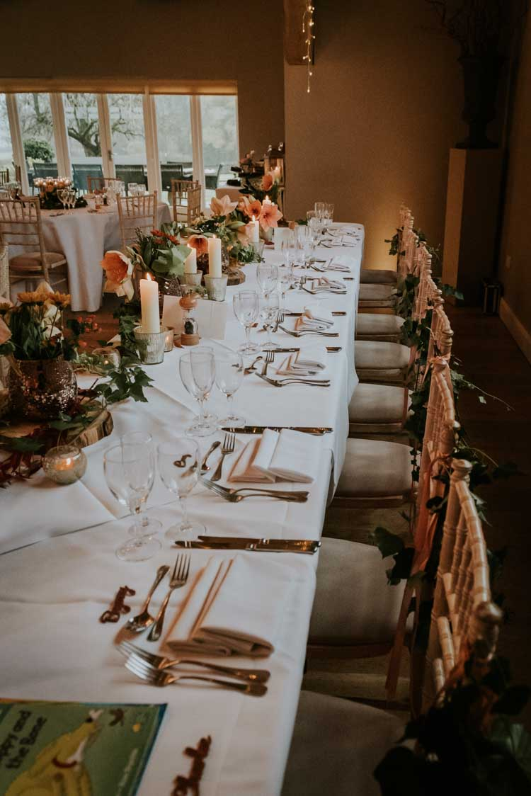 Table Decor Candles Flowers Rose Gold Autumn Barn Wedding http://www.weddingphotographyincheltenham.co.uk/