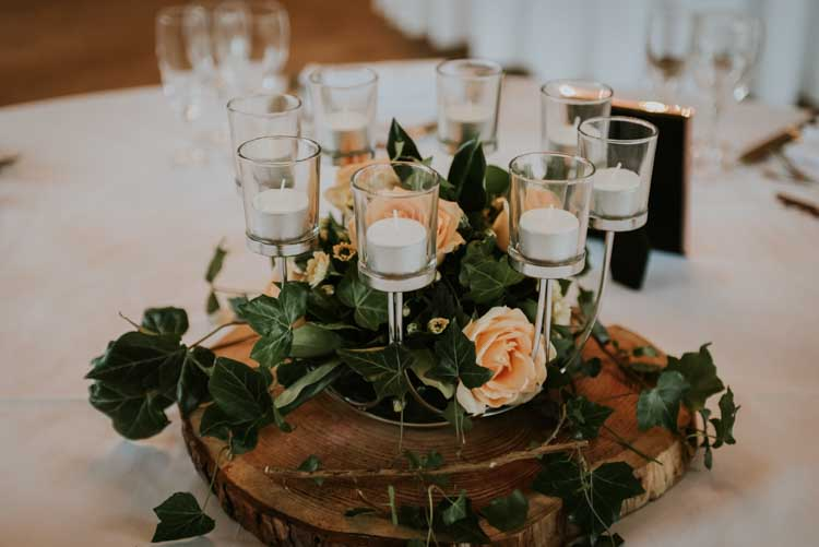 Candles Flowers Log Centrepiece Decor Rose Gold Autumn Barn Wedding http://www.weddingphotographyincheltenham.co.uk/