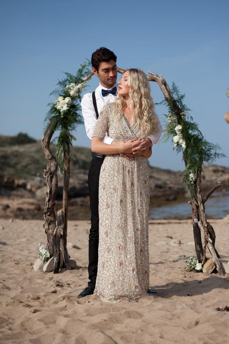 Driftwood Flower Arch Backdrop Luxe Bohemian Beach Wedding Ideas http://www.zoeemilie.co.uk/