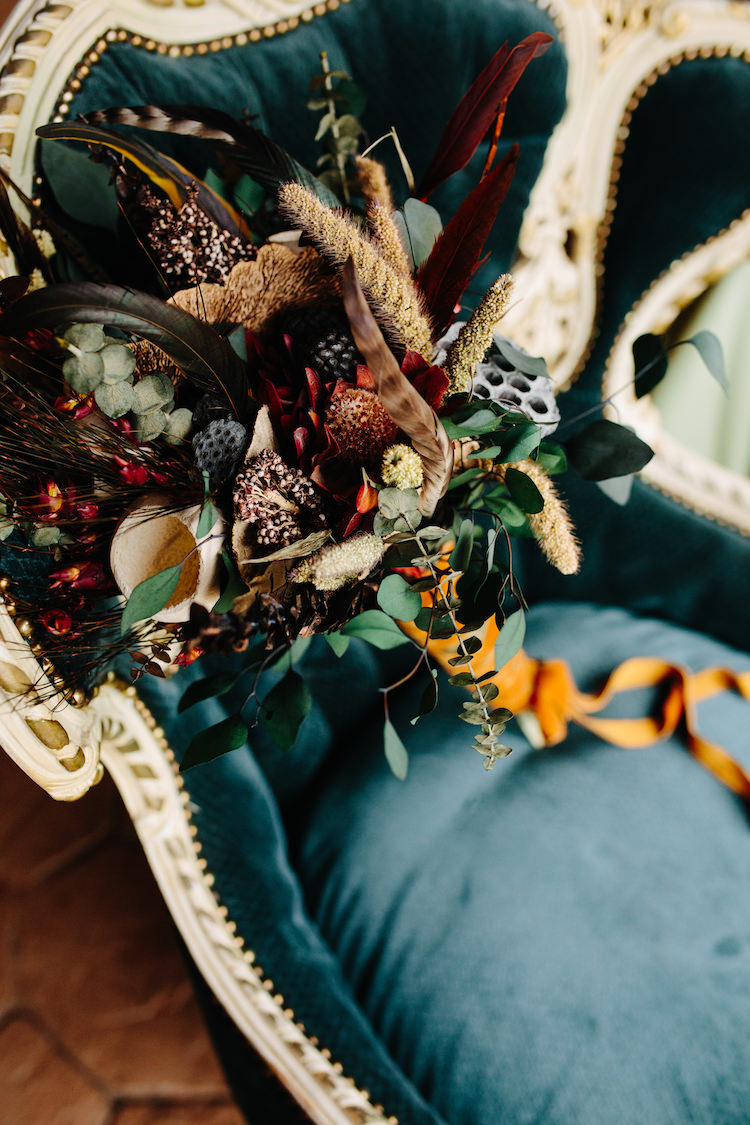 Bride Bouquet Dried Flowers Feathers Greenery Orange Antique Velvet Ribbon Vintage Green Chair Art Nouveau Autumn Burgundy Wedding http://www.jbonadiophoto.com/