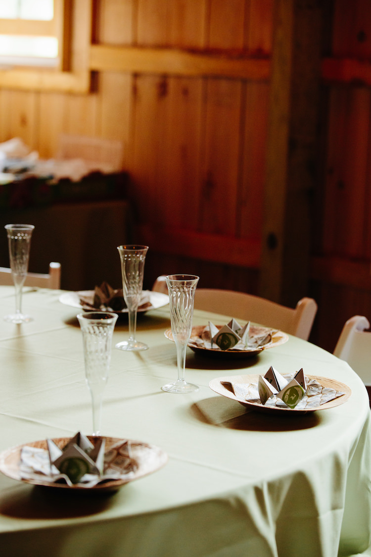 Table Setting Champagne Flutes Origami Green Table Cloth Barn Reception Art Nouveau Autumn Burgundy Wedding http://www.jbonadiophoto.com/