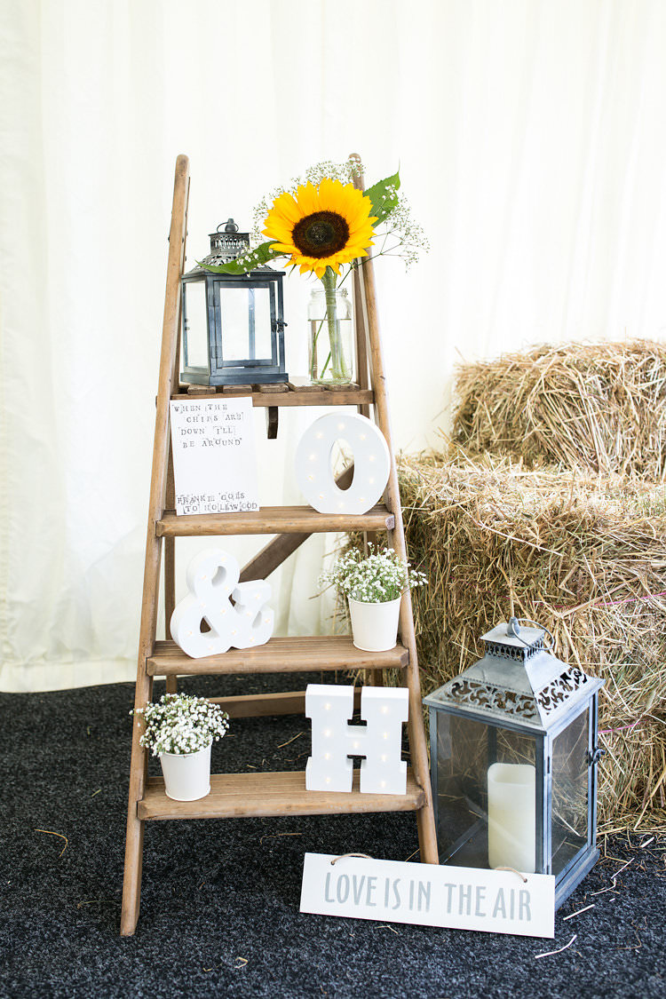 Wooden Ladder Decor Summer Sunflowers Marquee Wedding http://maddiewaters.co.uk/