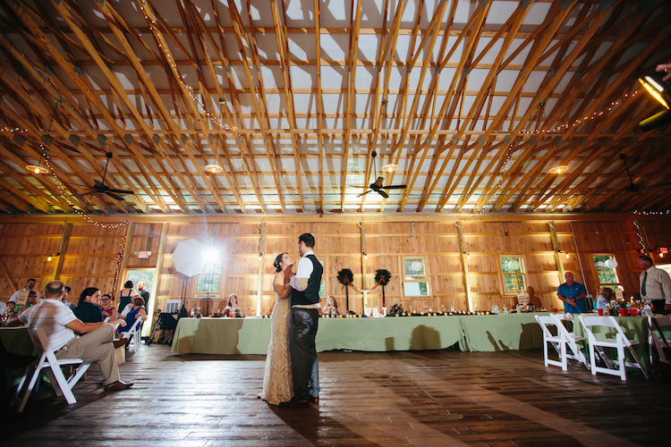 Barn Reception Fairy Lights Bride Groom First Dance Guests White Chairs Hanging Décor Art Nouveau Autumn Burgundy Wedding http://www.jbonadiophoto.com/