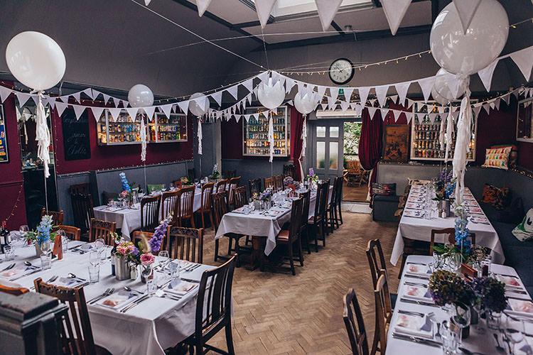 White Balloons Bunting Parquet Floor Fairy Lights Minimalist City 1970s East London Pub Wedding http://www.curiousrosephotography.com/