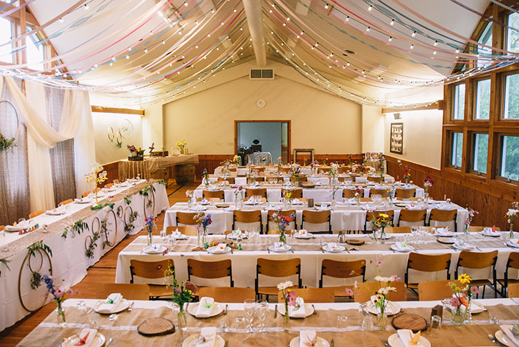 Reception Long Tables Hessian Lace Table Runners Hanging Décor Fairy Lights Multicoloured Ribbons Wooden Chairs Multicoloured Florals Glass Vases Woodland Waterfall Mint Wedding Ontario http://www.laurenmccormickphotography.com/