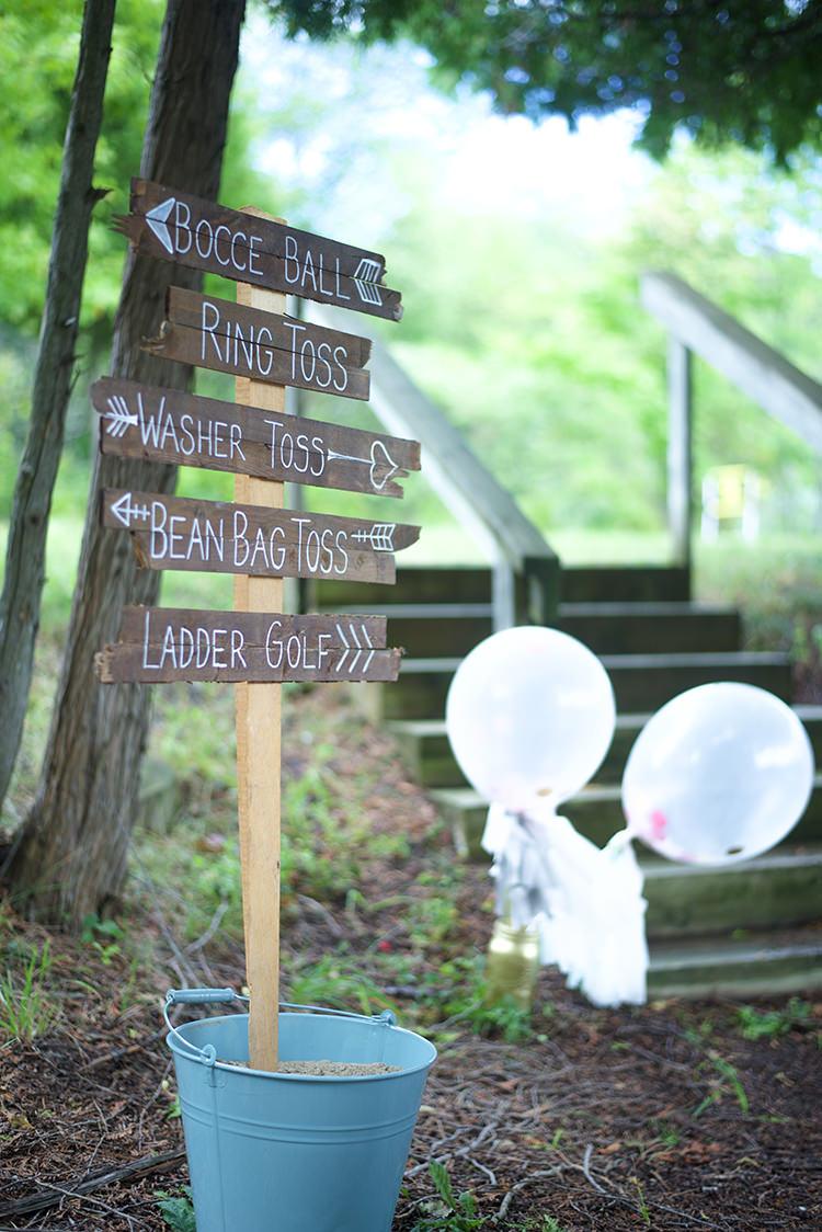 Outdoor Ceremony Handwritten Wooden Sign Directions Outdoor Games Blue Tin Bucket Large Balloons Woodland Waterfall Mint Wedding Ontario http://www.laurenmccormickphotography.com/