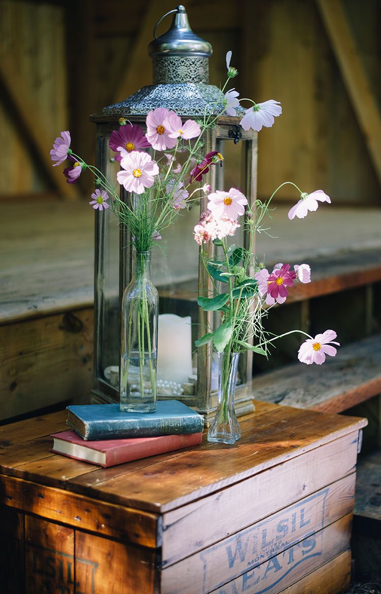 Outdoor Ceremony Rustic Décor Silver Candle Lantern Fresh Pink Purple Florals Glass Vases Vintage Books Wooden Box Woodland Waterfall Mint Wedding Ontario http://www.laurenmccormickphotography.com/