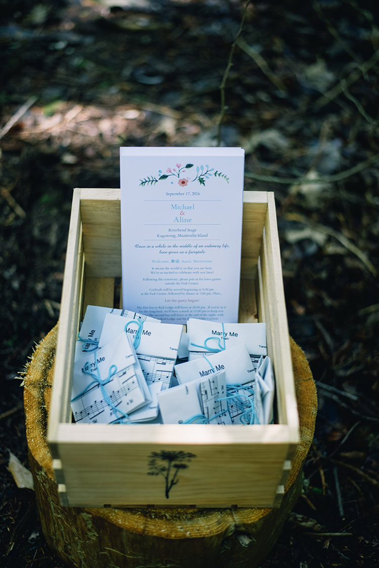 Outdoor Ceremony Wedding Stationery Invitation Sheet Music Ribbons Wooden Crate Woodland Waterfall Mint Wedding Ontario http://www.laurenmccormickphotography.com/