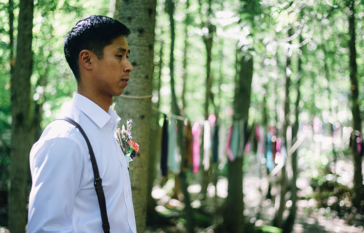 Outdoor Ceremony Groom White Shirt Brown Leather Suspenders Multicoloured Floral Buttonhole Hanging Décor Ribbons Trees Woodland Waterfall Mint Wedding Ontario http://www.laurenmccormickphotography.com/