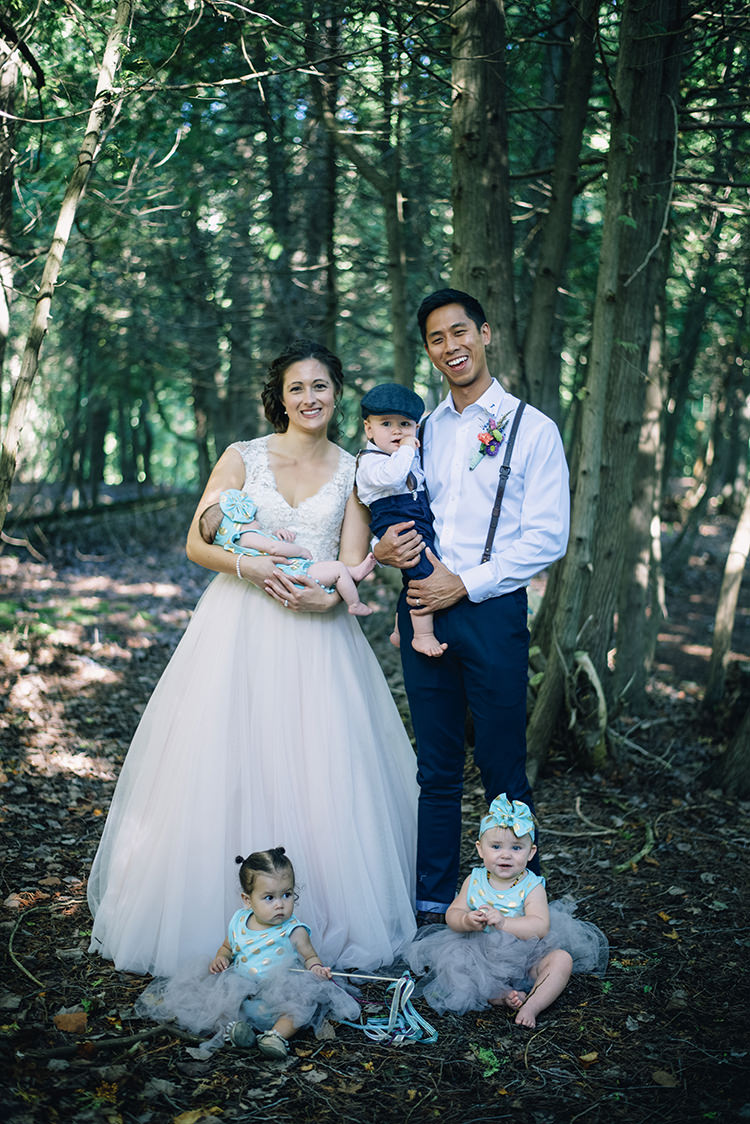 Bride Allure Champagne Lace Tulle Bridal Gown Groom White Shirt Brown Leather Suspenders Navy Pants Multicoloured Floral Buttonhole Flower Girls Mint Gold Headbands Page Boy Navy Pants Suspenders Woodland Waterfall Mint Wedding Ontario http://www.laurenmccormickphotography.com/
