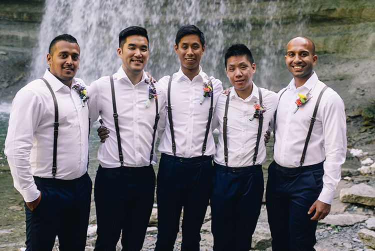 Groom Groomsmen White Shirts Brown Leather Suspenders Navy Pants Multicoloured Floral Buttonholes Woodland Waterfall Mint Wedding Ontario http://www.laurenmccormickphotography.com/