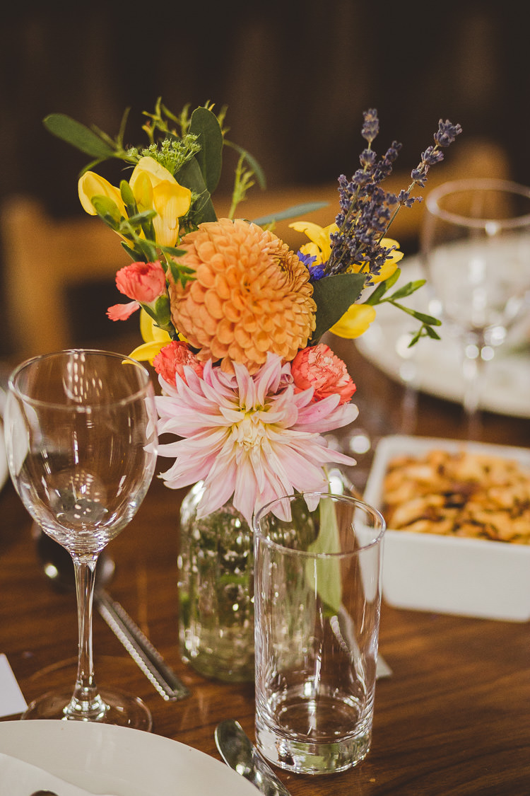 Flowers Bottles Dahlia Autumn Orange Pink Yellow Eclectic Whimsical Village Hall Wedding http://www.nicolacasey.photography/
