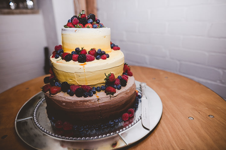 Chocolate Cake Berries Eclectic Whimsical Village Hall Wedding http://www.nicolacasey.photography/