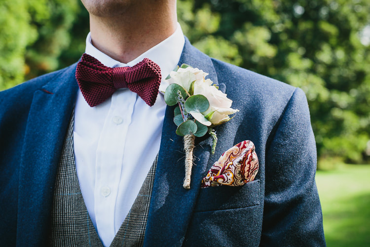 Knitted Red Bow Tie Rose Buttonhole Groom Bohemian Outdoor Country Wedding https://www.alexapoppeweddingphotography.com/