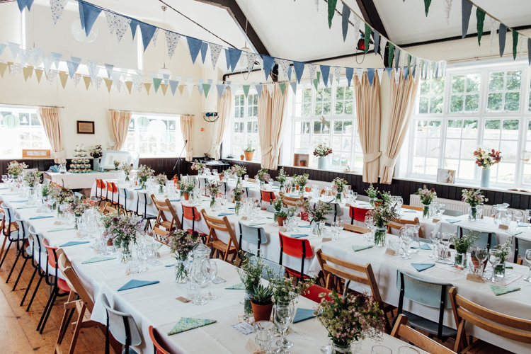 Bunting Blue White Long Table Industrial Wooden Chairs Rural Handfasting Village Hall Wedding http://www.annapumerphotography.com/