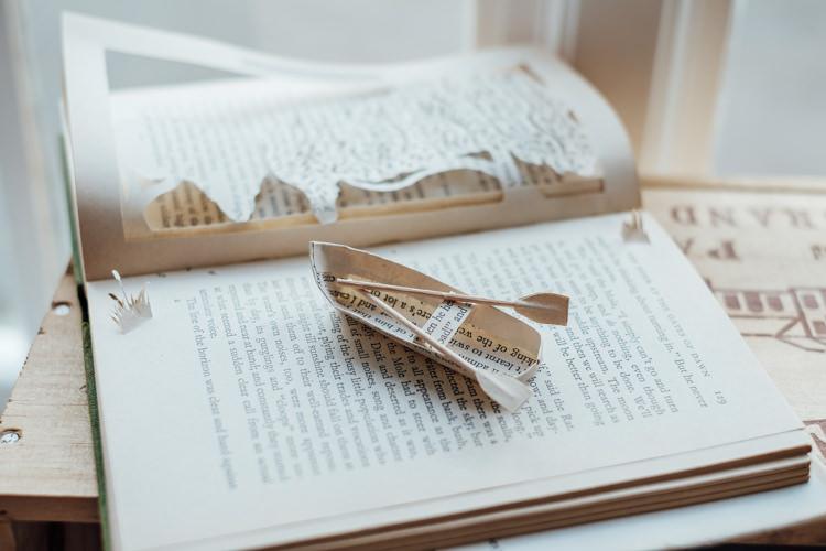 Paper Cut Books Art Display Decor Rural Handfasting Village Hall Wedding http://www.annapumerphotography.com/