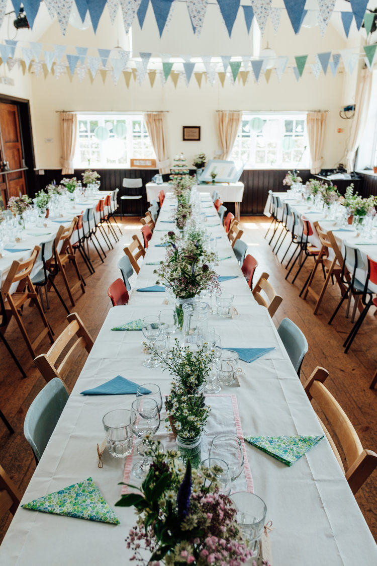 Blue White Bunting Flowers Tables Long Chairs Rural Handfasting Village Hall Wedding http://www.annapumerphotography.com/