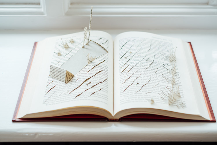 Paper Cut Books Art Display Decor Rural Handfasting Village Hall Wedding http://www.annapumerphotography.com/