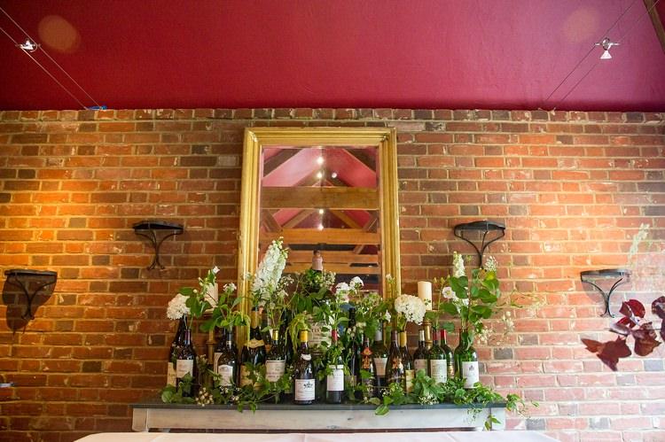 Wine Bottle Flowers White Greenery Tabe Mantle Romantic Summer Country Blush Wedding http://katherineashdown.co.uk/