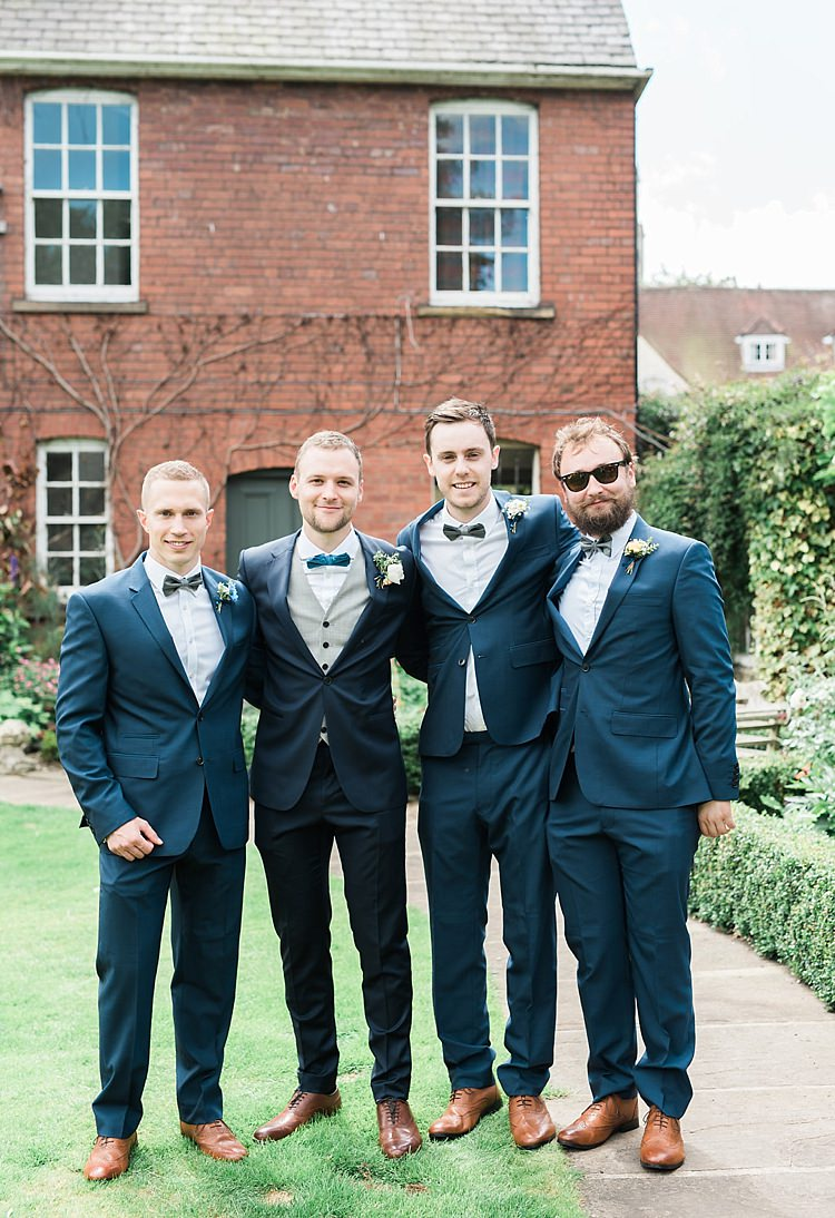 Groom Groomsmen Navy Blue Suits Tan Shoes Bow Ties Chic Natural Garden Wedding