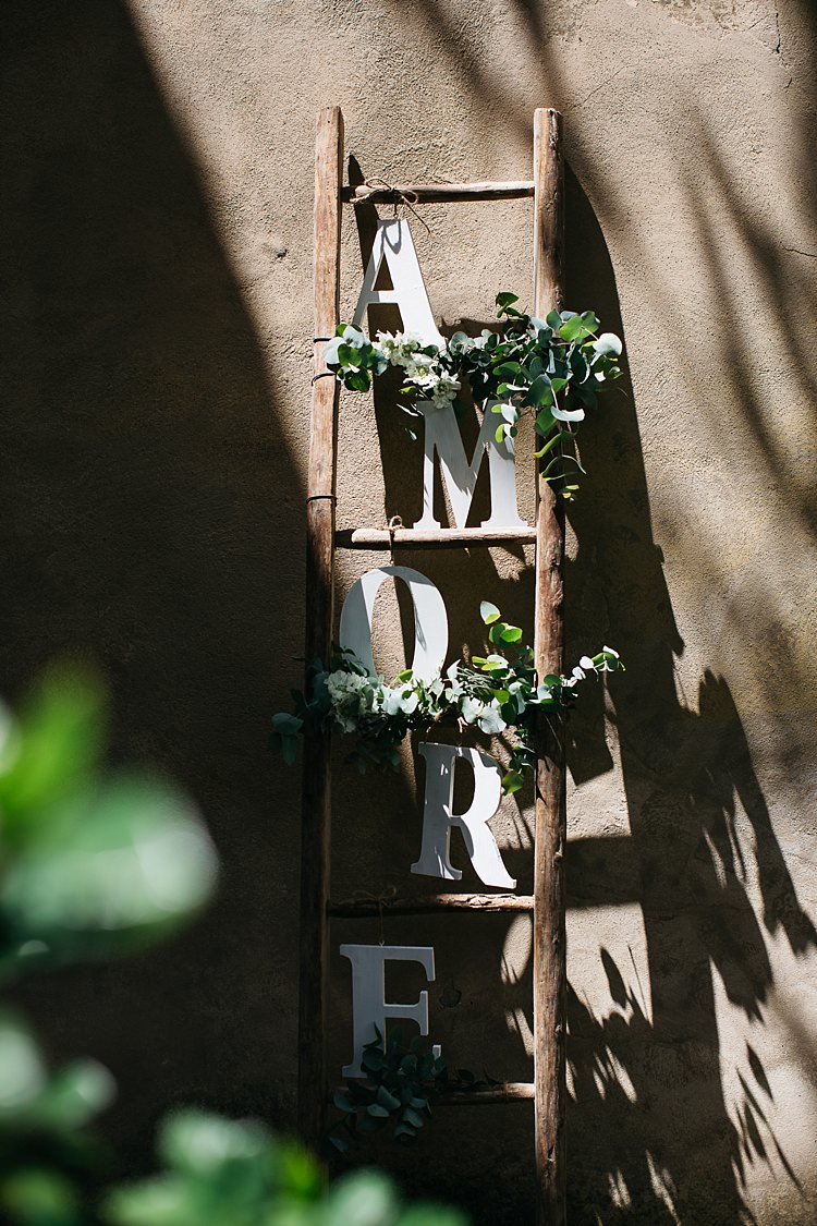 Ceremony Décor Wooden Ladder White Florals Greenery Large Letters Amore Rustic Chic Greenery Wedding Ideas in Tuscany http://www.tastino0.it/