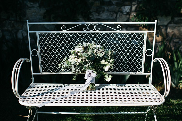 Bride Bouquet White Roses Greenery Long Ribbon White Chair Garden Rustic Chic Greenery Wedding Ideas in Tuscany http://www.tastino0.it/