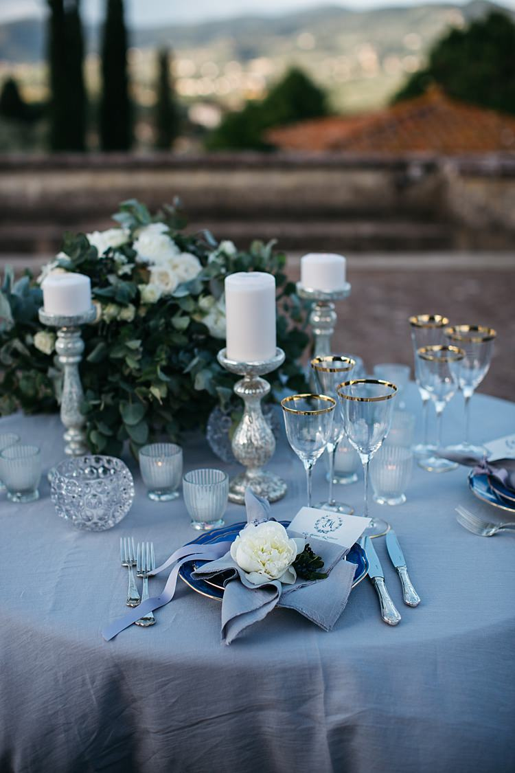 Reception Table Setting White Roses Greenery Silver Candlesticks White Black Stationery Calligraphy Fresh White Flower Silver Cutlery Rustic Chic Greenery Wedding Ideas in Tuscany http://www.tastino0.it/