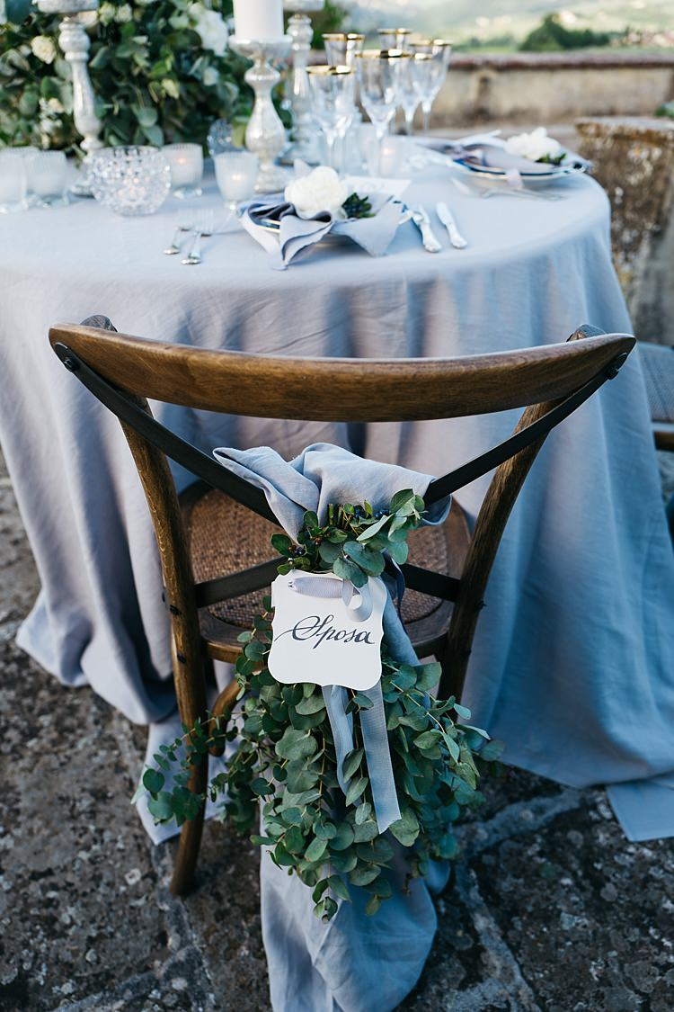 Reception Table Setting Wooden Chair Calligraphy Tag Grey Ribbon Greenery Grey Tablecloth Silver Candlesticks Rustic Chic Greenery Wedding Ideas in Tuscany http://www.tastino0.it/