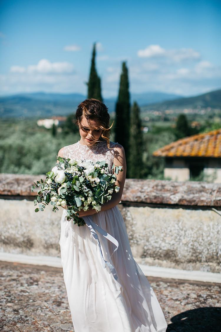 Bride High Neck Lace Tulle Bridal Gown Bouquet White Florals Greenery Long Ribbon Beautiful Views Rustic Chic Greenery Wedding Ideas in Tuscany http://www.tastino0.it/