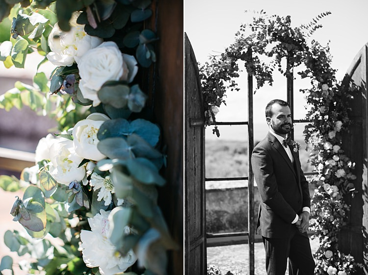 Outdoor Ceremony Groom Charcoal Pinstripe Suit Green Patterned Bowtie Wooden Archway White Roses Greenery Rustic Chic Greenery Wedding Ideas in Tuscany http://www.tastino0.it/