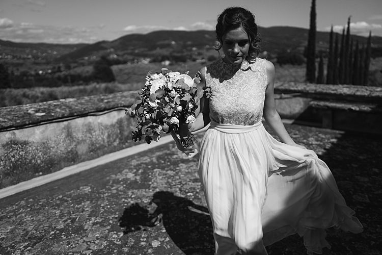 Bride High Neck Lace Tulle Bridal Gown Bouquet White Roses Greenery Loose Curls Hairstyle Rustic Chic Greenery Wedding Ideas in Tuscany http://www.tastino0.it/