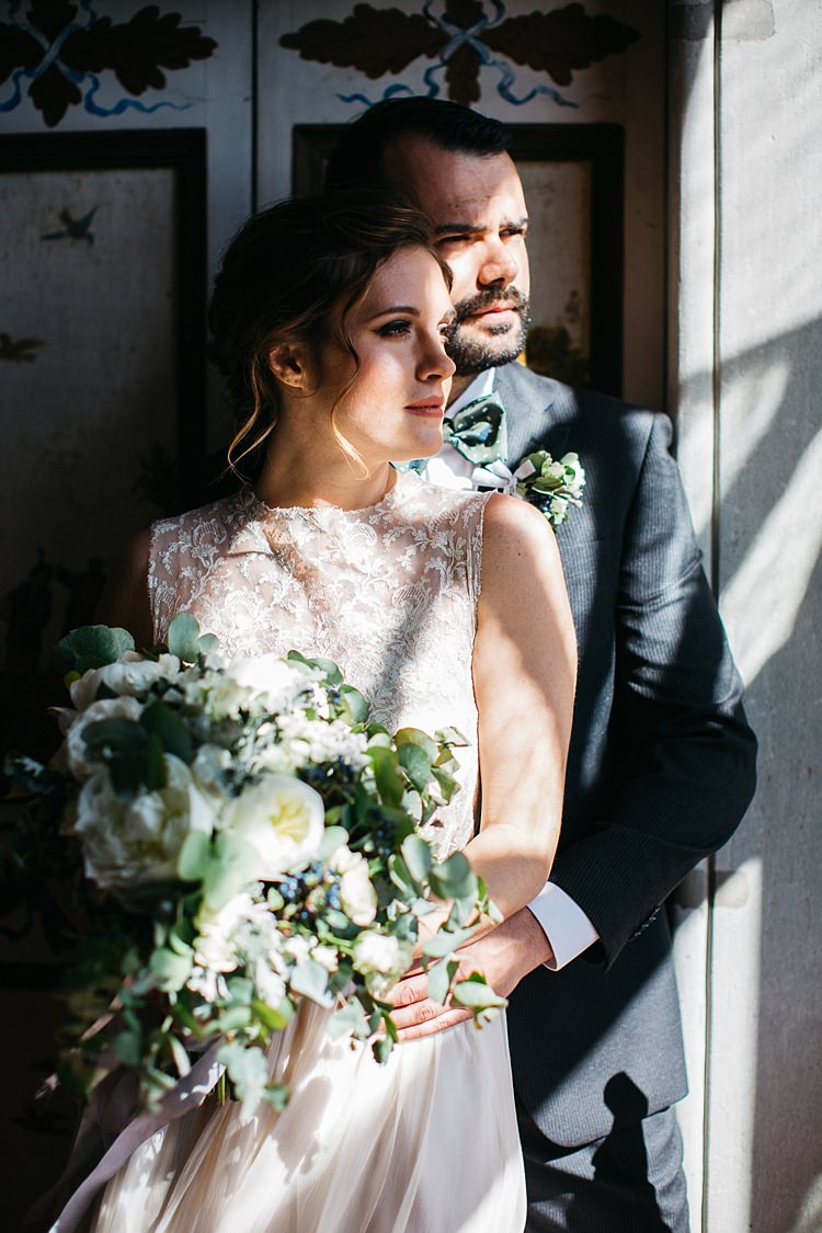 Bride High Neck Lace Tulle Bridal Gown Bouquet White Roses Greenery Groom Charcoal Pinstripe Suit Green Patterned Bowtie Shadows Rustic Chic Greenery Wedding Ideas in Tuscany http://www.tastino0.it/