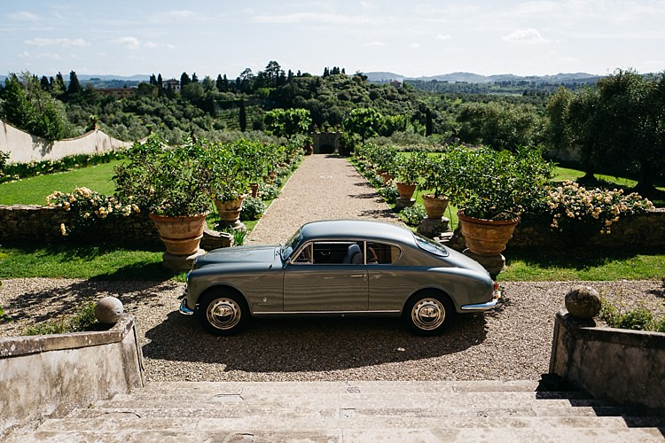 Outdoor Staircase Vintage Grey Car Large Potted Plants Green Lawn Trees Rustic Chic Greenery Wedding Ideas in Tuscany http://www.tastino0.it/