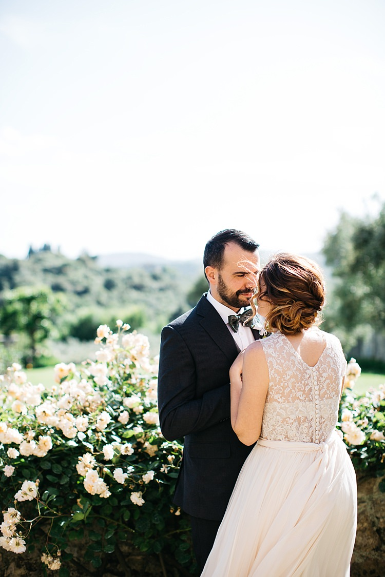 Bride High Neck Lace Tulle Bridal Gown Buttons Groom Charcoal Pinstripe Suit Green Patterned Bowtie White Rose Bush Rustic Chic Greenery Wedding Ideas in Tuscany http://www.tastino0.it/