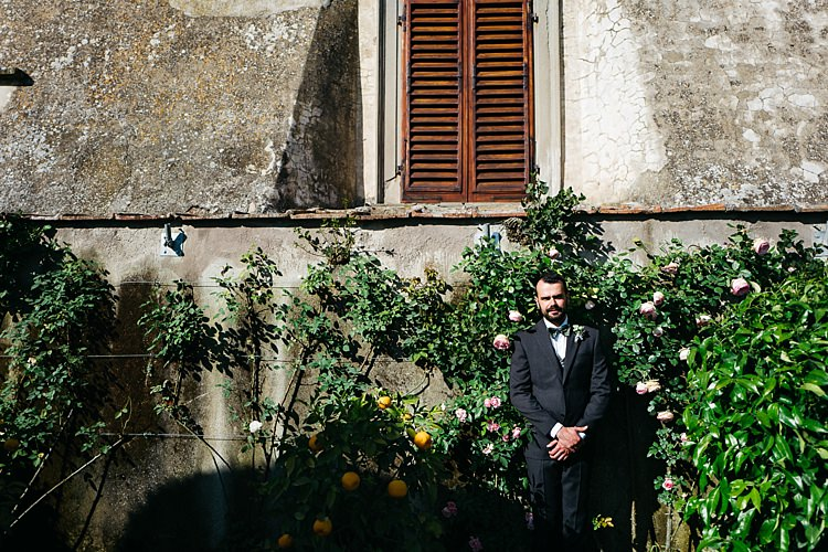 Groom Charcoal Pinstripe Suit Green Patterned Bowtie Florals Green Bushes Rustic Chic Greenery Wedding Ideas in Tuscany http://www.tastino0.it/