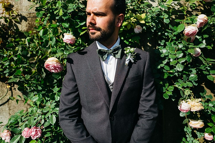 Groom Charcoal Pinstripe Suit Green Patterned Bowtie Pink Rose Bush Rustic Chic Greenery Wedding Ideas in Tuscany http://www.tastino0.it/