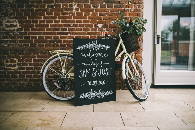 Bicycle Bike Flowers Decor Welcome Sign Black Chalk Board Magical Bohemian Barn Wedding http://www.jamespowellphotography.co.uk/