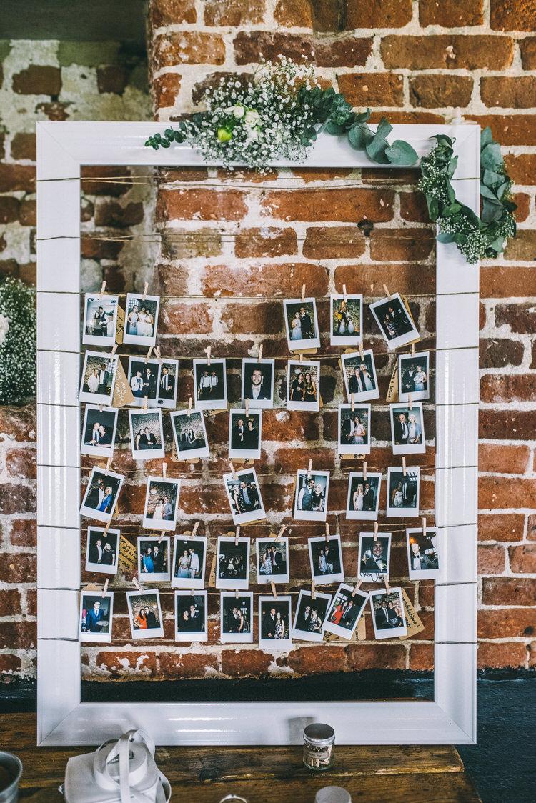 Photos Wall Decor Polariod Pegs Frame Magical Bohemian Barn Wedding http://www.jamespowellphotography.co.uk/