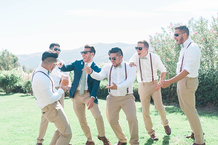 Groom Navy Jacket Beige Pants Light Green Tie Sunglasses Groomsmen White Shirt Green Bowtie Leather Suspenders Beige Pants Brown Leather Shoes Soft Blush Sage Green Wedding California http://julia-rosephotography.com/