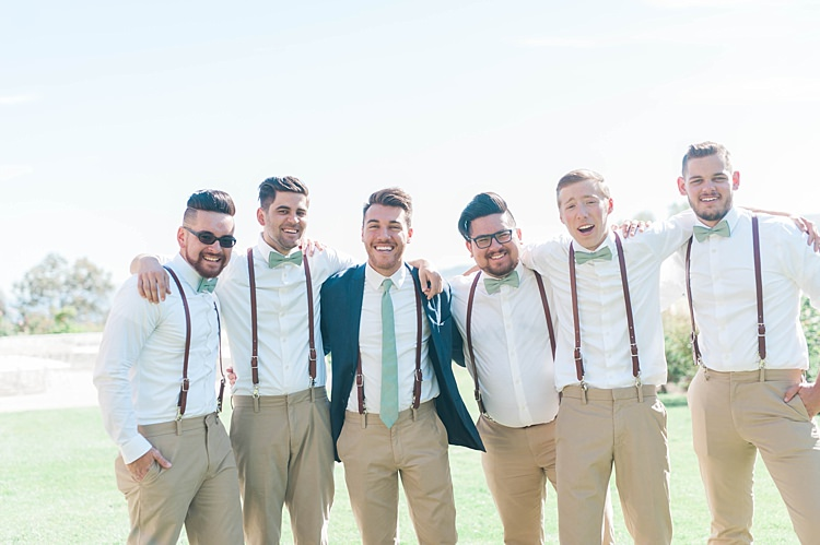 Groom Navy Jacket Beige Pants Light Green Tie Groomsmen White Shirt Green Bowtie Leather Suspenders Beige Pants Soft Blush Sage Green Wedding California http://julia-rosephotography.com/