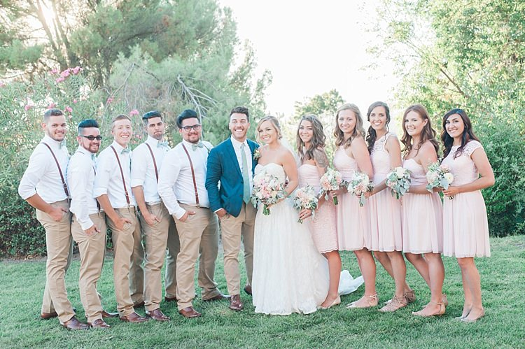 Bridal Party Bride Lace Sweetheart Strapless Bridal Gown Veil Bouquet White Pink Green Florals Groom Navy Jacket Light Green Tie Beige Pants Bridesmaids Blush Multi Style Dresses Bouquets Groomsmen White Shirts Green Bowties Leather Suspenders Beige Pants Soft Blush Sage Green Wedding California http://julia-rosephotography.com/