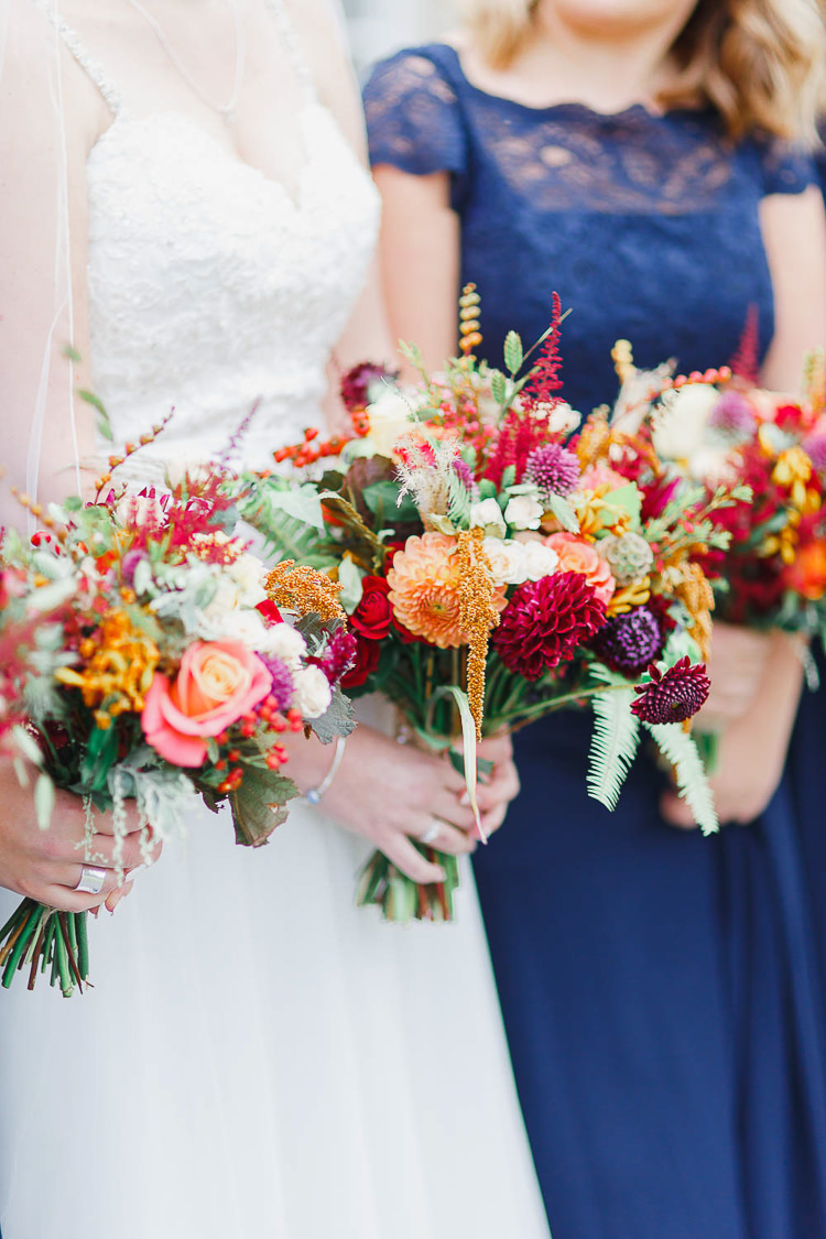 Bouquet Flowers Red Orange Dahlia Rose Bride Bridal Berry Bridesmaids Magical Fairy Lit Autumn Barn Wedding http://whitestagweddings.com/