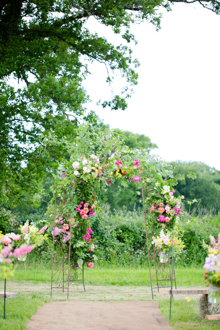 Flower Floral Arch Backdrop Outdoor Ceremony Colourful Pastel Home Made Farm Wedding http://helencawtephotography.com/