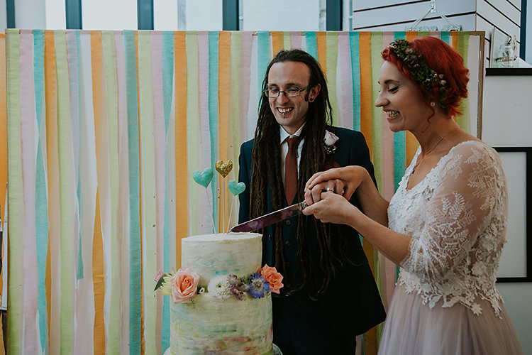 Ribbon Paper Backdrop Cake Table Colourful Crafty Relaxed Watercolour Wedding https://suesliquephotography.com/