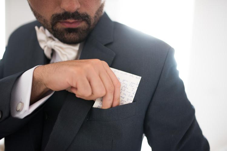 Groom Black Suit White Shirt White Bowtie Handwritten Vows Romantic Outdoor Castle Tuscany Wedding http://www.natalymontanari.com/