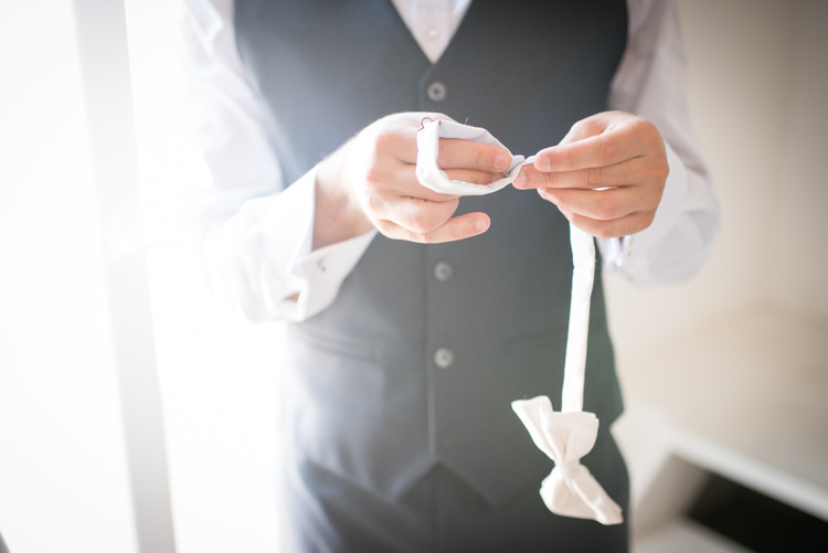 Groom White Shirt Black Vest White Bowtie Getting Ready Romantic Outdoor Castle Tuscany Wedding http://www.natalymontanari.com/