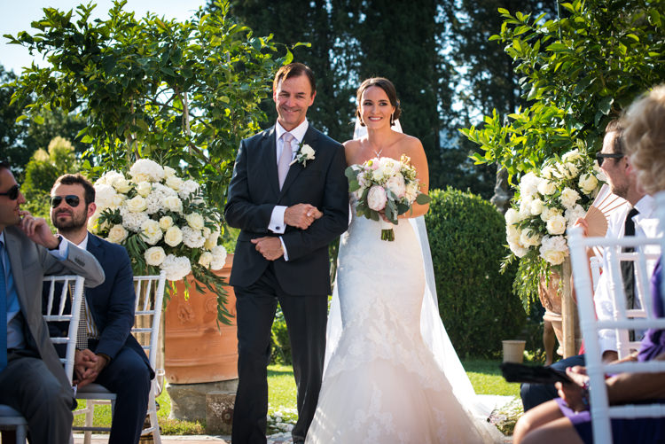 Outdoor Ceremony Bride Lace Fitted Mermaid Bridal Gown Bouquet White Pink Peony Florals Father Entrance Guests White Chairs White Roses Greenery Romantic Outdoor Castle Tuscany Wedding http://www.natalymontanari.com/