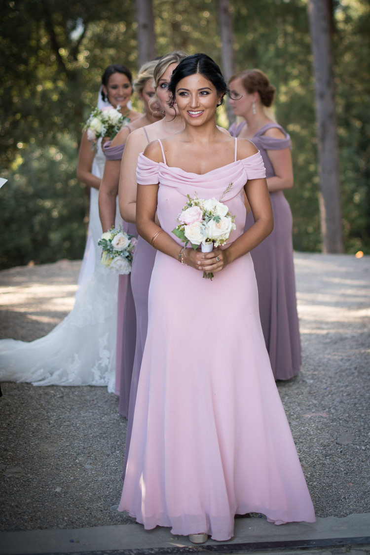 Ceremony Entrance Bridesmaids Soft Pink Purple Dresses Bouquet White Pink Rose Peony Flowers Bride Fitted Lace Mermaid Bridal Gown Veil Romantic Outdoor Castle Tuscany Wedding http://www.natalymontanari.com/
